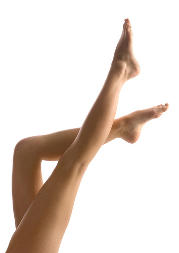 Woman legs over white background.